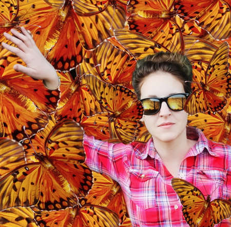 Woman among butterflies photo