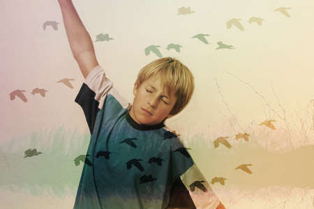 child who dreams of flying like birds photo