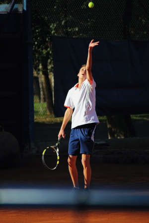 Doing the serve in the match photo
