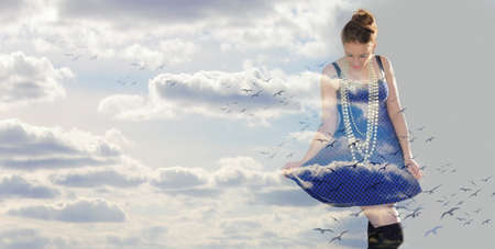 woman in the clouds and birds Stock Photo