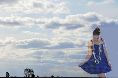 Happy woman in the clouds.
