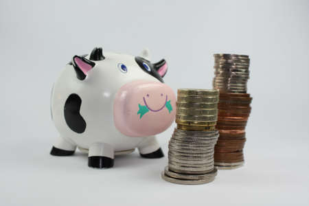 cash cow: cash cow with piles of coins