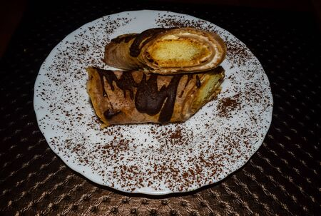 Closeup of sections of tiramisu pancakes with cocoa sprinkles