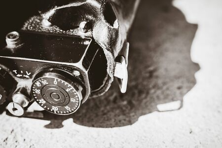 Black and white closeup of a vintage film camera control dials