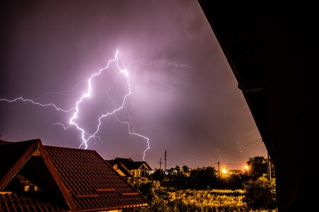 Lightning storm over a residential area Imagens