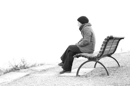 lonely woman sitting on a park bench