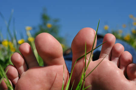 barefooted: pair of feet relaxing in tranquil nature Stock Photo