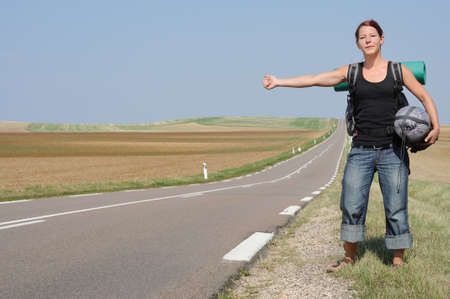 pick up: hitchhiking woman travelling by hitchhike