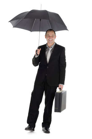 protected businessman with  umbrella photo