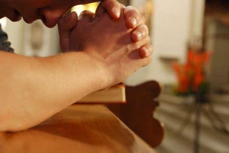 kneel: person praying in church Stock Photo