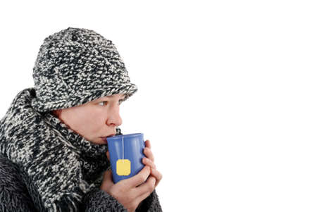 wintriness: woman drinking drink cup of hot tea Stock Photo