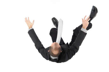 to stumble: falling businessman Stock Photo