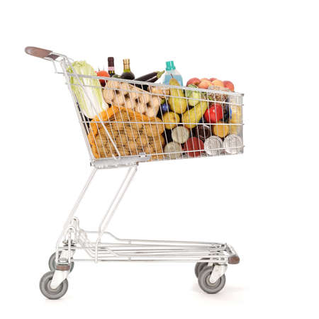 supermarket shopping cart full of foodstuff food photo