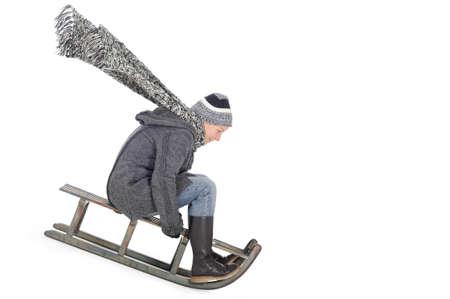 Woman racing on her sled winter fun
