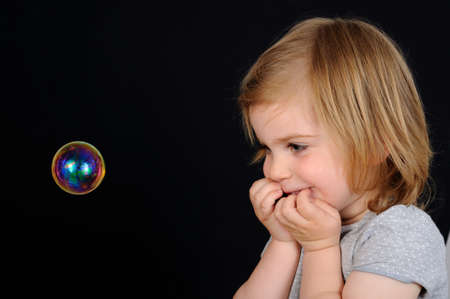 fascination: Kid girl fascinated by bubble