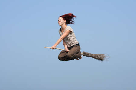 Woman flying on her besom