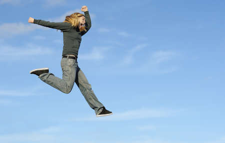 Young woman making a fun jump photo