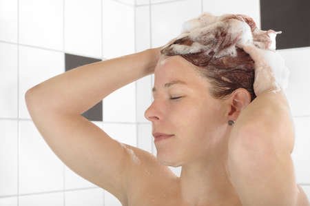 shampooing: Woman washing her hair