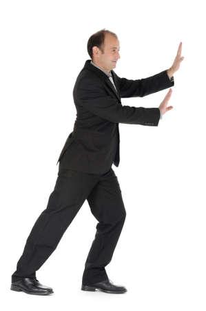aside: Working businessman pushing something