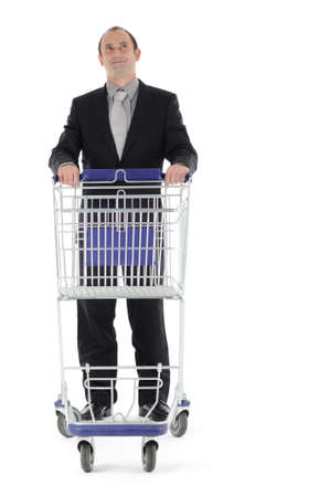 Man with shopping cart photo