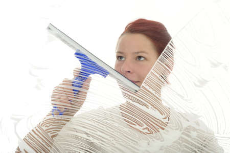 soaping: Woman cleaning glass with squeegee