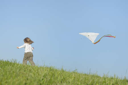 Girl playing with kite photo