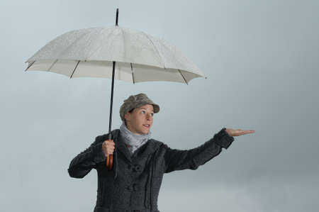 Woman with umbrella checking the weather photo