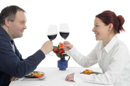 Couple on dinner clinking with red wine