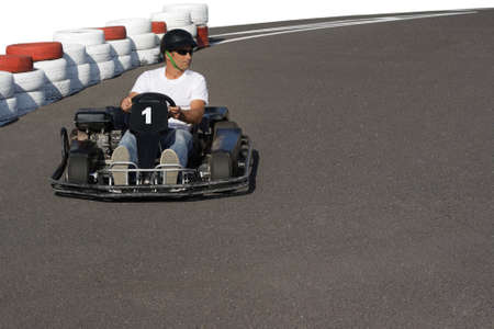 carting: Man racing on the carting track Stock Photo