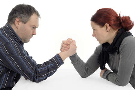 battle of the sexes: Man woman couple conflict arm wrestling