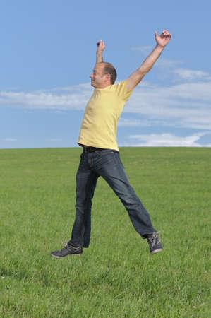 downtime: Jumping active man enjoying outdoor recreation Stock Photo