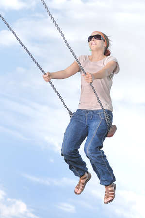 swing set: Woman swinging on swing set