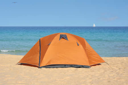 Camping tent on tranquil beach