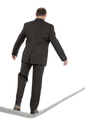 Businessman walking the tightrope