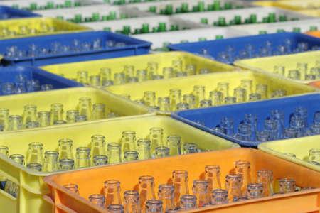 Bunch of empty beverage glass bottles in crates Reklamní fotografie