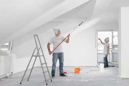 Couple painting renovating