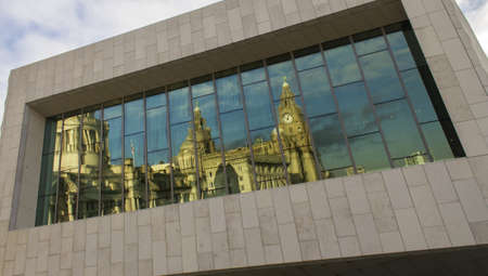 The Three Graces reflected in the Museum of Liverpool, Liverpool, England Stock Photo