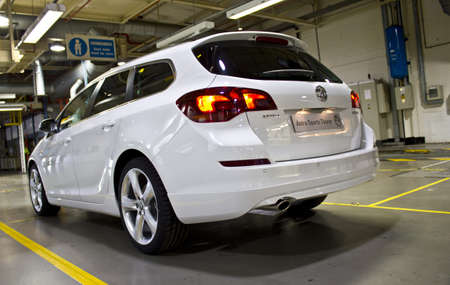 White Vauxhall Astra Sports Tourer, at the Vauxhall factory, Ellesmere port, England