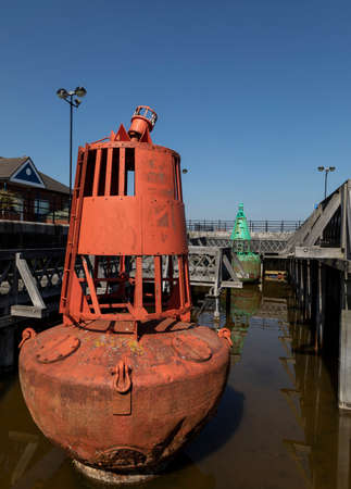 Red & green buoys at Woodside Ferry, Birkenhead, Wirral, stored next to the ferry terminal Stock Photo