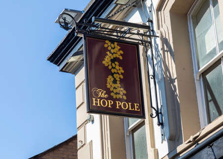 An exterior mounted pub sign for the pub The Hop Pole Warrington Cheshire May 2018 Editorial