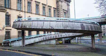 Circular concrete brutalist footpath with railings at the rear of the World Museum Liverpool January 2019