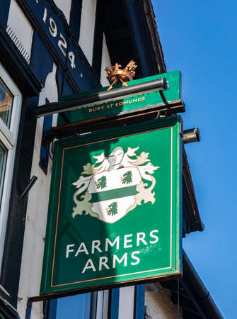 Exterior sign for the Farmers Arms public house part of the Greene King chain Wallasey Village February 2019 Editorial