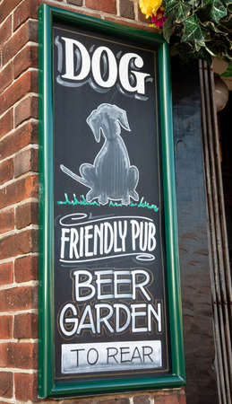 Chalkboard sign outside a public house indicating a dog friendly pub with beer garden Wallasey Village February 2019