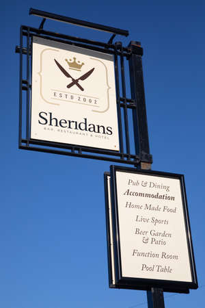Exterior sign for Sheridans bar restaurant and hotel indicating services provided Wallasey Village February 2019