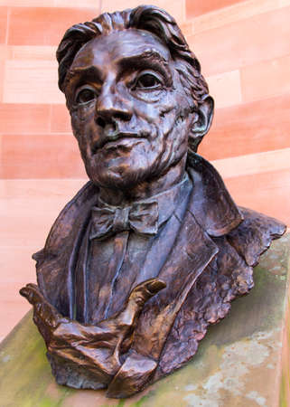 Bronze bust of Sir John Barbirollo on a plinth outside the Bridgewater Hall Manchester England February 2013 Banque d'images - 117243637