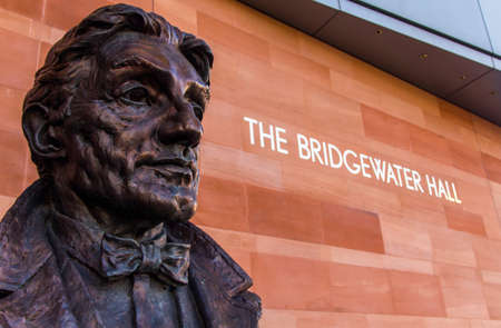 Bronze bust of Sir John Barbirollo on a plinth outside the Bridgewater Hall Manchester England February 2013