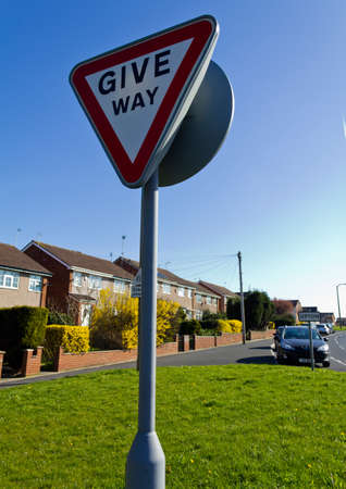 Give way sign on a sunny day by the side of a road in Upton Wirral England March 2012