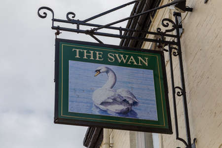 Exterior sign for The Swan public house St Helens Lancashire March 2019 Editorial