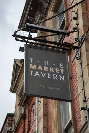 Exterior sign for The Market Tavern public house St Helens  Lancashire March 2019 Editorial