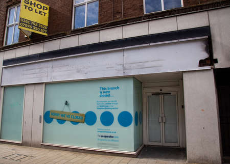 Empty retail unit for a bank on a high street St Helens Merseyside March 2019